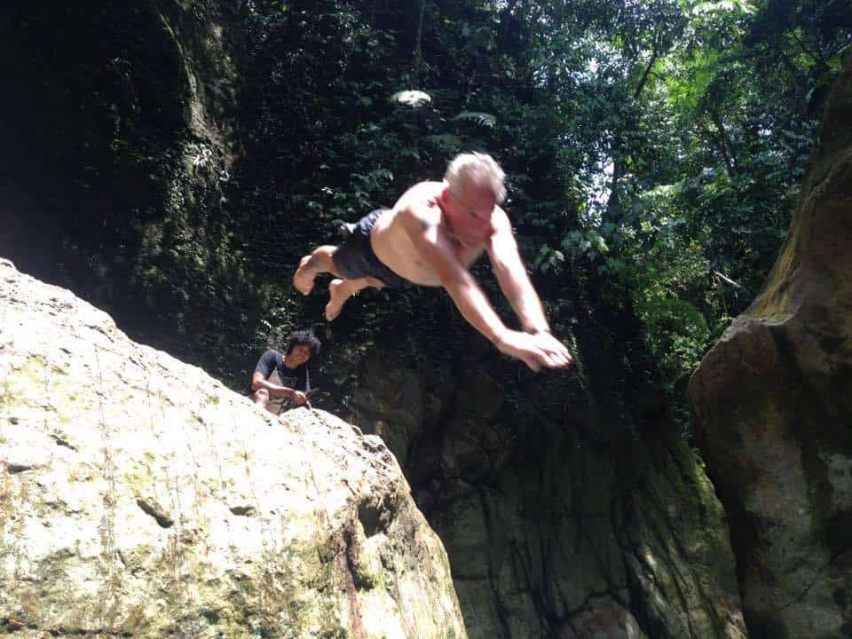 Cliff diving in the jungle is all part of the thrill of travelling Sumatra