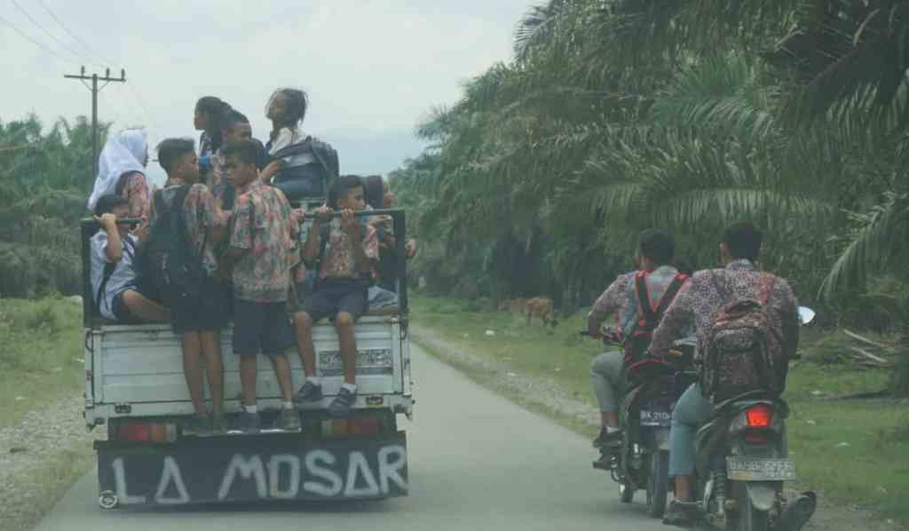Local kids on the back of a truck, Sumatra