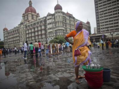 sells drinking water near the Taj Mahal hotel in Mumbai