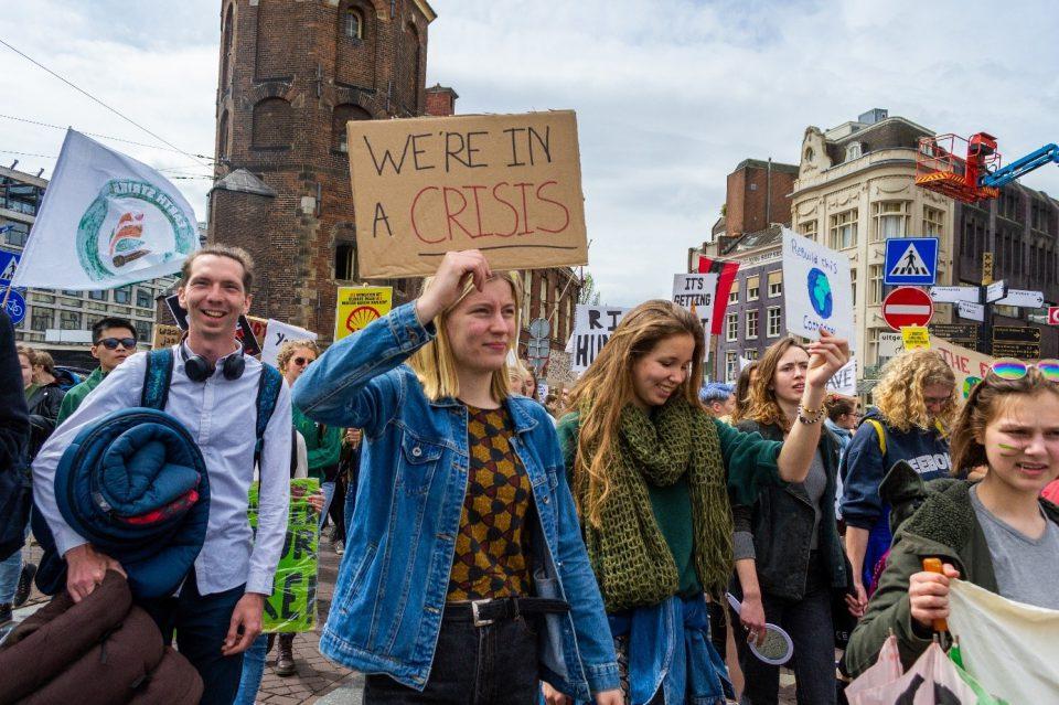 stakers in actie bij de klimaatmars in Amsterdam.