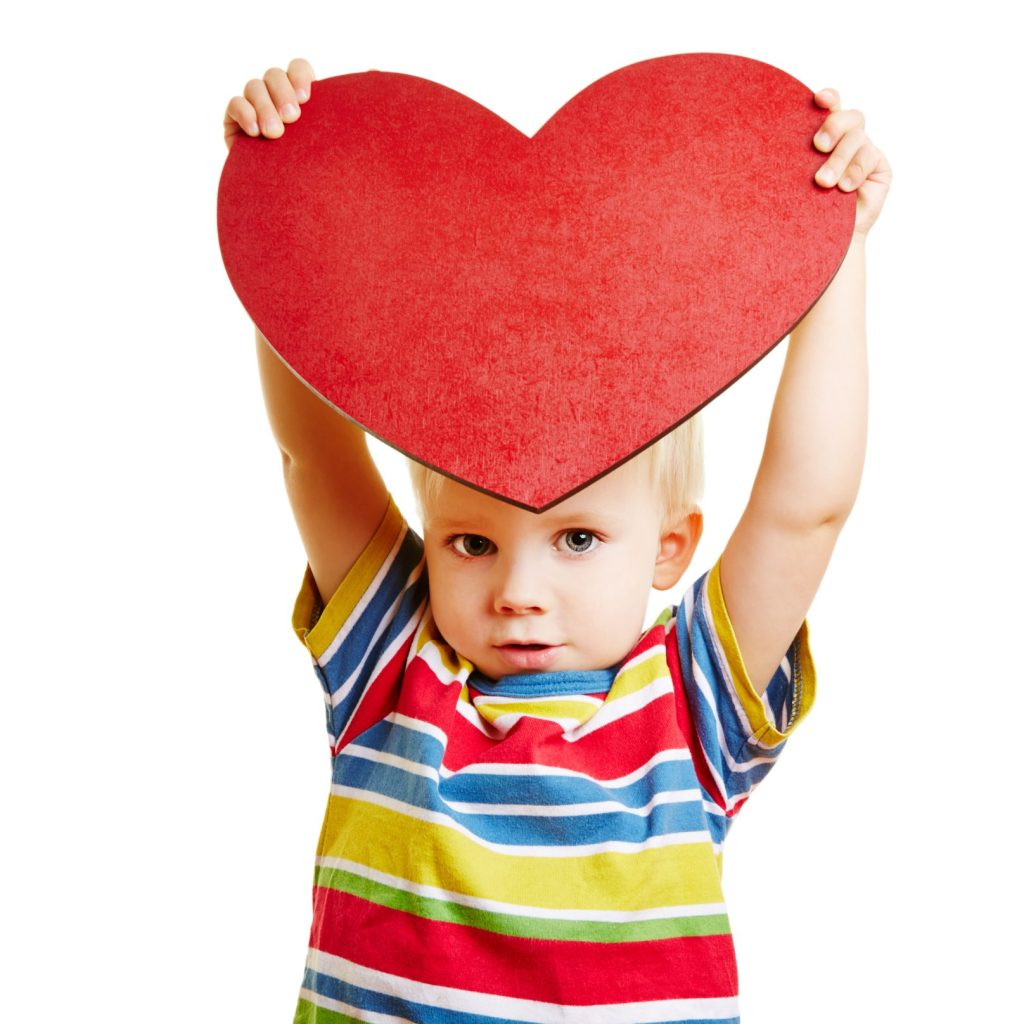 Foster child holding heart
