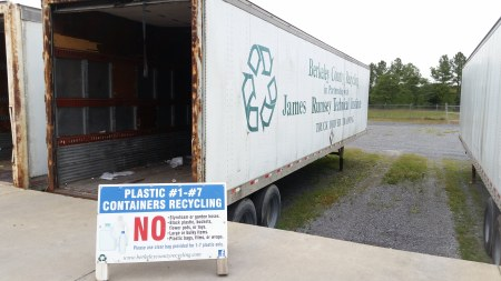 An empty trailer waits to be loaded with plastic waste for recycling.