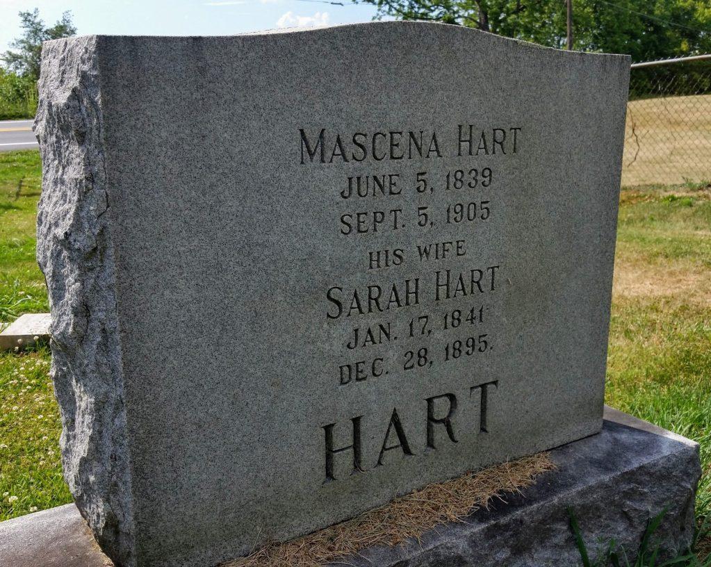An imposing granite headstone marks the burial plot of Mascena and Sara Hart.