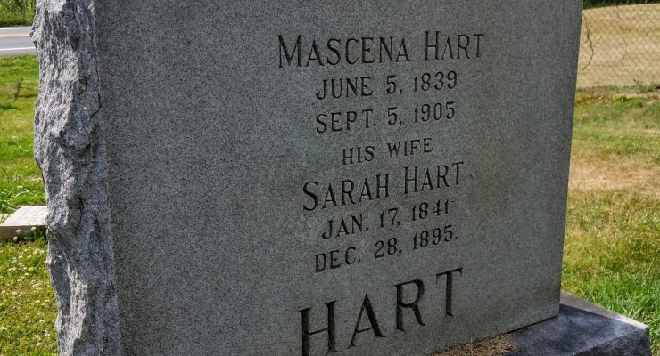 An imposing granite headstone marks the burial plot of Mascena and Sara Hart.