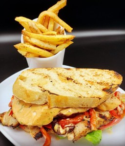 A mouthwatering sandwich and a side of fries.