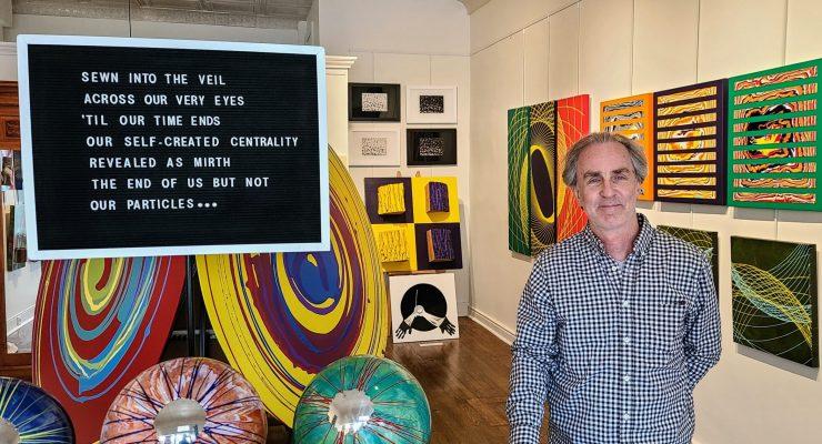 John Walsh at his art exhibit in the Evolve gallery Shepherdstown.