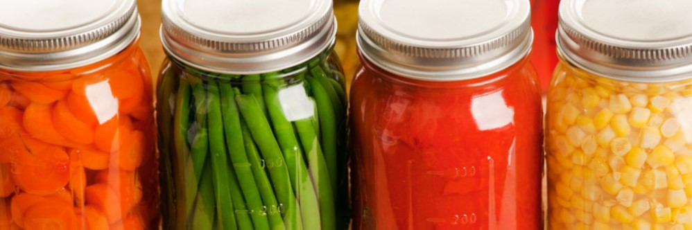 canning jars filled with colorful produce.