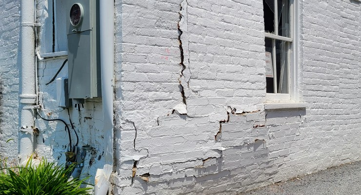 The initial impact was on the rear wall but the stress rippled through the structure to damage the east wall.