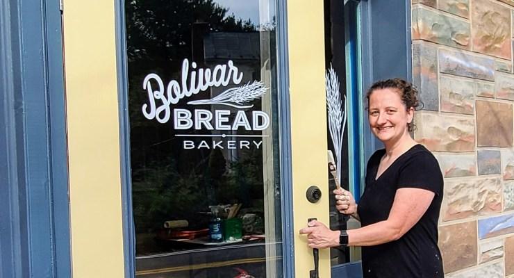 Katie Kopsick opens the new door at Bolivar Bread's new location.