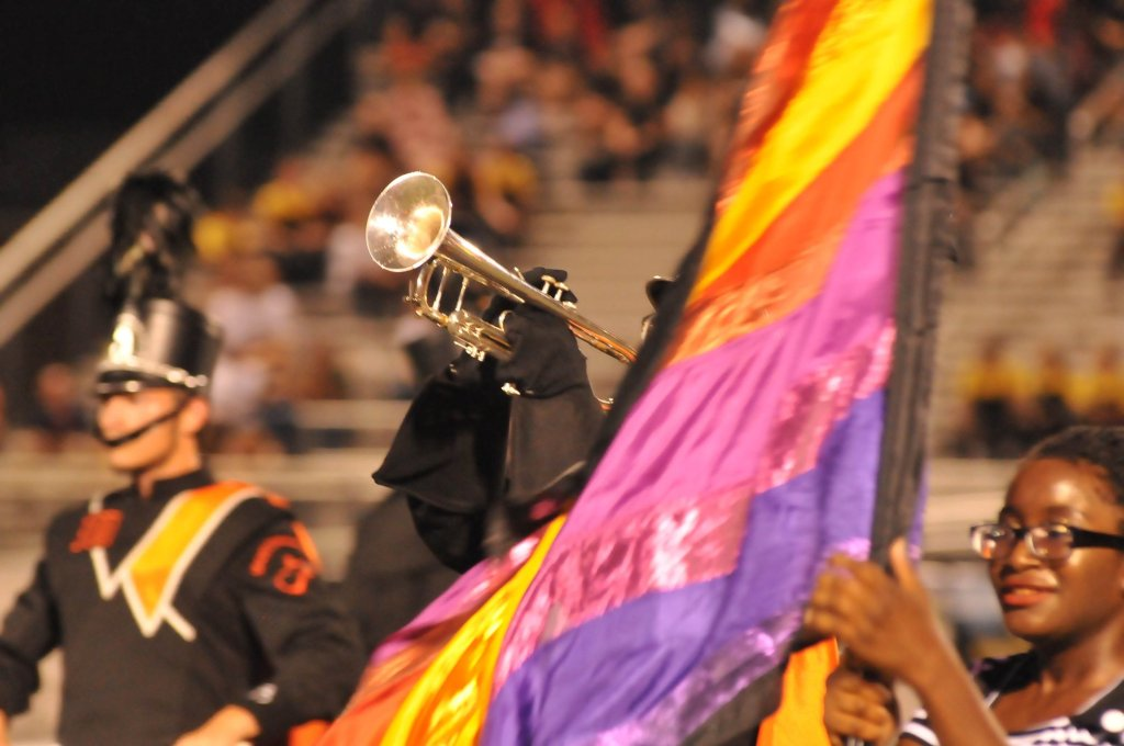 Marching band members perform.