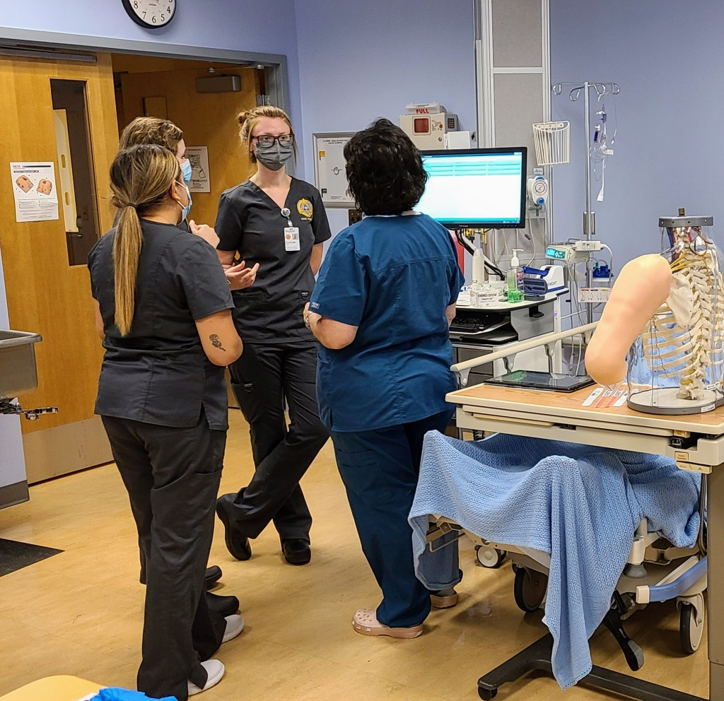 Nursing students work closely with teachers and mentors in the simulation labs.