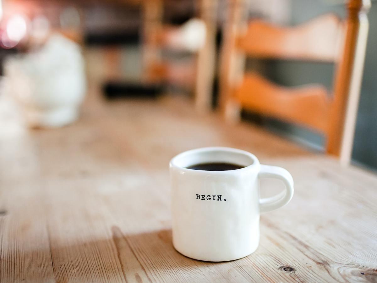 A mug of tea which says 'begin'