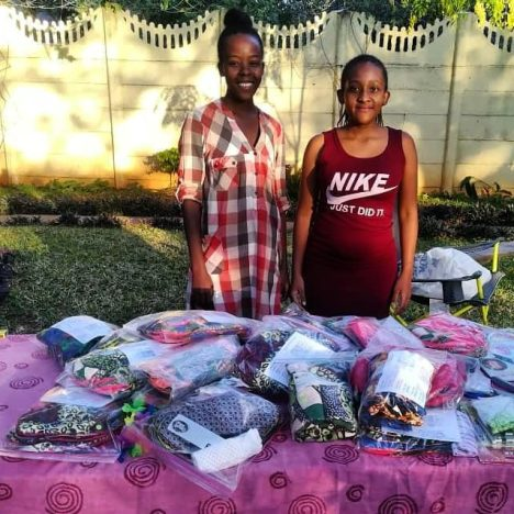 Volunteers of the Victoria Falls community partner to make reusable sanitary pads for returnees and women in need