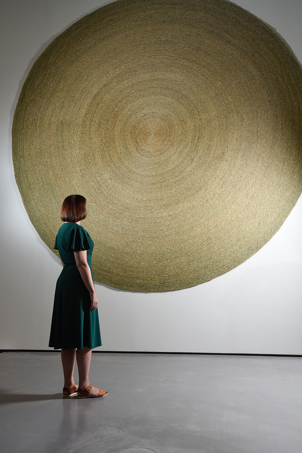 One of the first visitors to Anthea Hamilton Reimagines Kettle's Yard views Handwoven grass mats, 2016 by Anthea Hamilton. Exhibition opens to the public on Thursday 15 September at The Hepworth Wakefield. Photo © Darren O'Brien/Guzelian. Courtesy The Hepworth Wakefield.