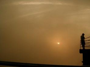 sun hidden behind clouds