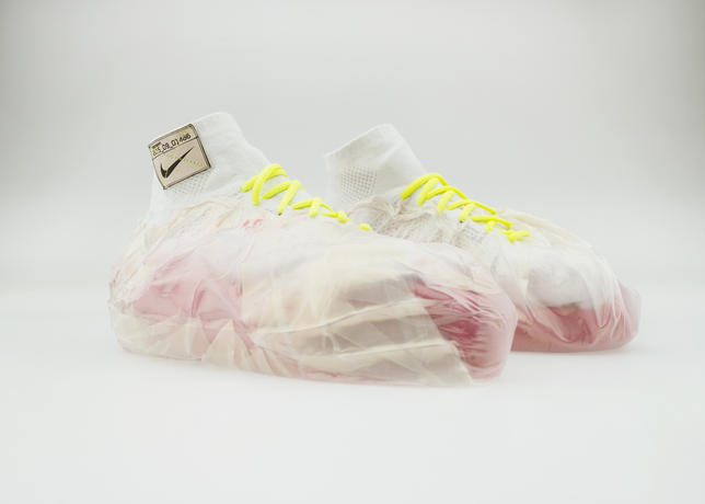 This sculptural design rethinks impact protection by filling plastic bags with kinetic sand, which mimics the cohesive physical properties of wet sand, to configure an adaptable cushioning system that cradles the athlete's foot.