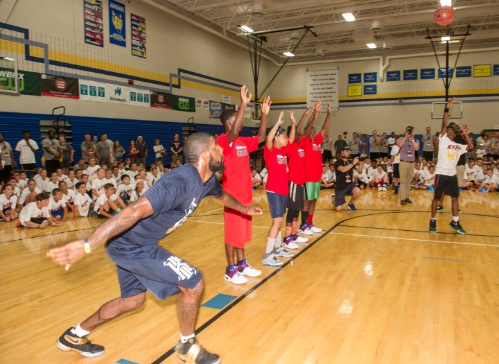 Cleveland Cavaliers star Kyrie Irving plays with members of the Boys & Girls Clubs of Cleveland at his basketball camp Saturday, July 9, 2016, in Independence, Ohio. Kids Foot Locker donated 190 pairs of sneakers to BGCC, to match Irving's 190 points scored during the NBA championship series.  (Phil Long/AP Images for Kids Foot Locker)