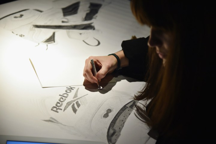 NEW YORK, NY - OCTOBER 11:  Artist Steph Morris sketches during Reebok's launch of the new Instapump Fury Overbranded at Pop Up Shop in NYC on October 11, 2016 in New York City.  (Photo by Bryan Bedder/Getty Images for Reebok)