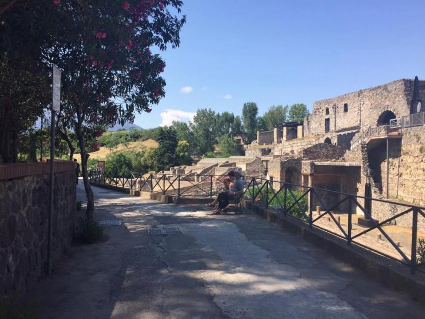 An image from the Pompeii ruins with scenic backdrop.