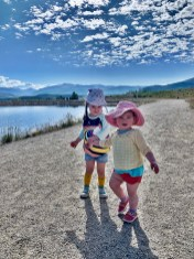 sisters holding hands at Old Dillon Reservoir Trail