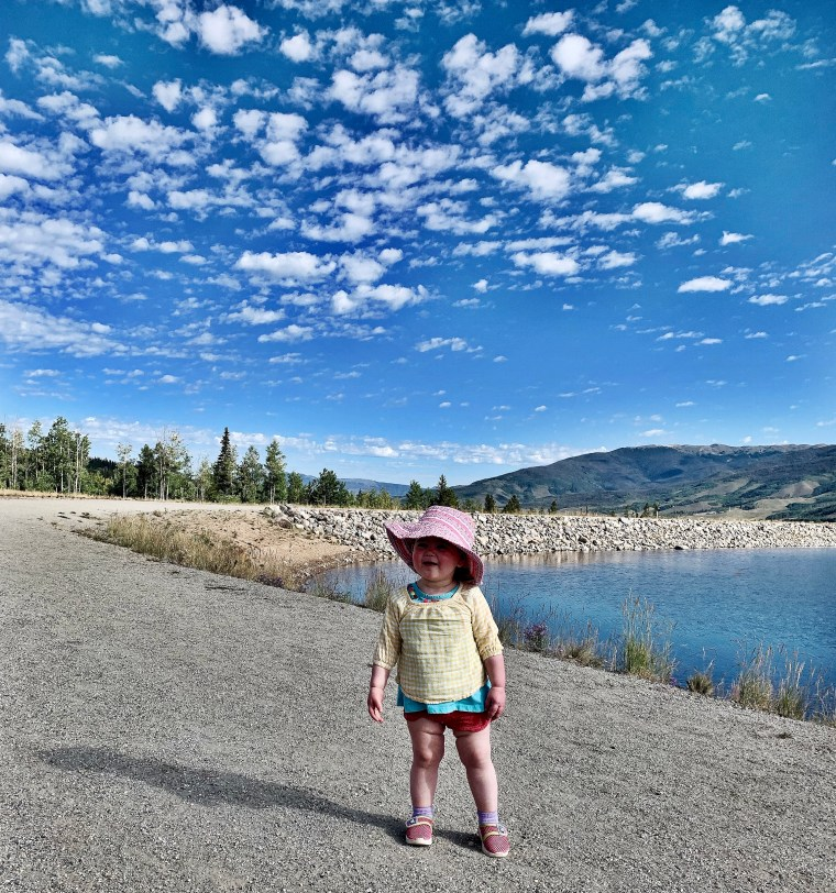 little girl taking in the view at Old Dillon Reservoir Trail