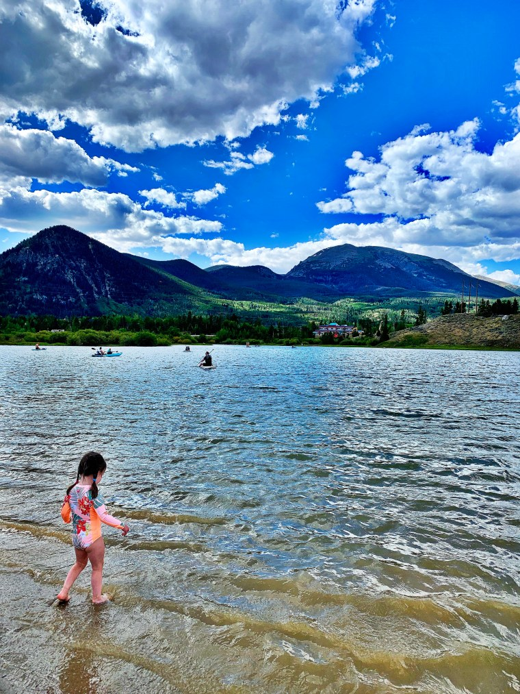 young girl watching kayakers in frisco bay marina, colorado