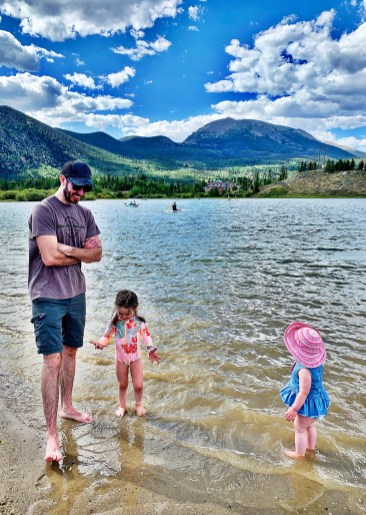 dad and two daughters playing in frisco bay marina, colorado