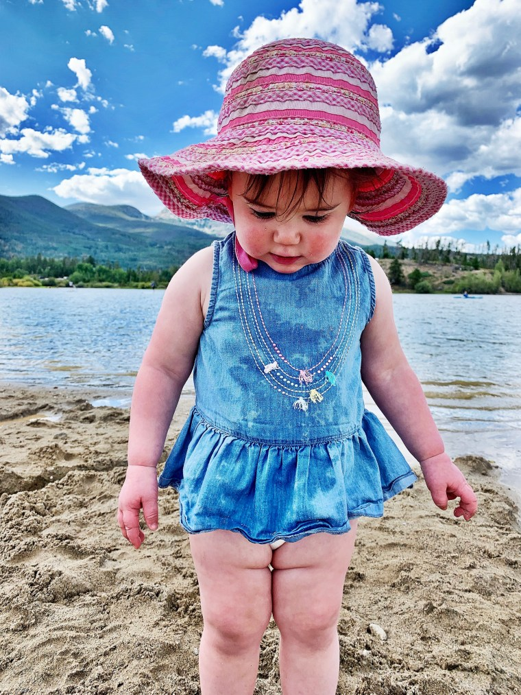 young girl in the sand at frisco bay marino, colorado