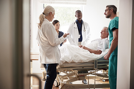 Physicians making rounds in healthcare facility