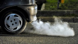 A vehicle releasing emissions