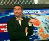 A meteorologist in front of a map