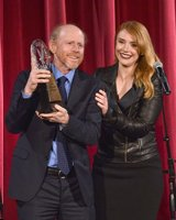 STATUESQUE PRESENTATION--Ron receiving his DGA Honors award from daughter Bryce.