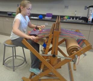 Group floor loom weaving