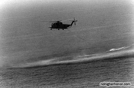 An RH-3D Sea Stallion helicopter from U.S. Navy Helicopter Mine Countermeasures Squadron 14 (HM-14) tows a mine-clearing device through the waters of the Persian Gulf on 1 August 1987 during Operation Earnest Will.
