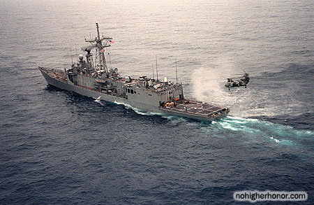 A port quarter view of the guided missile frigate USS SAMUEL B. ROBERTS (FFG-58) under tow by the tug Hunter after the ship struck a mine on Apr. 14, 1988.