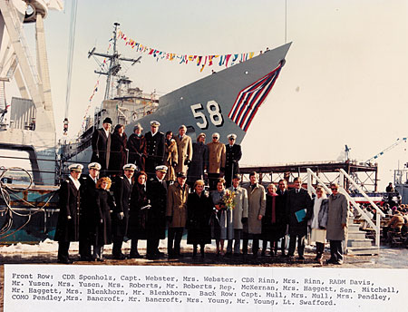 The official party assembles before USS Samuel B. Roberts (FFG 58). Among them are prospective CO Cmdr. Paul Rinn, BIW CEO William Haggett, Sen. Mitchell and Rep. McKernan of Maine.