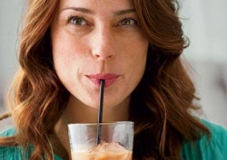 Woman in green drinking a weight loss smoothie