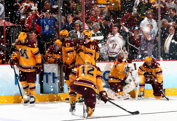 The University of Minnesota bench looks through the confetti as Union College celebrated their first national title with a 7-4 victory over the Gophers.