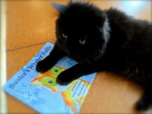Phoebe reads Buster's Winter Folly
