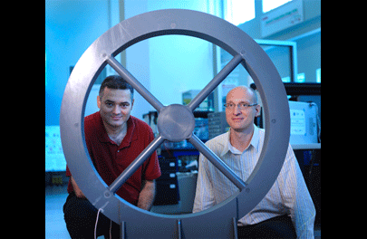 PhD student Zeljko Pantic and Dr. Srdjan Lukic (right) pose with their prototype.