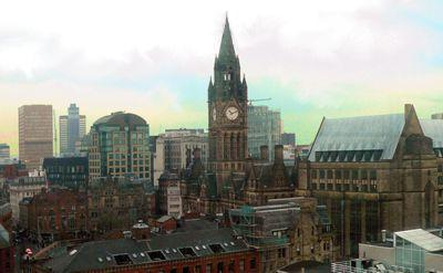 Manchester skyline on a dull December morning, showing the Town Hall and its Extension