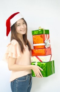 holiday shopper with gifts caminoel by freedigitalphotos.net