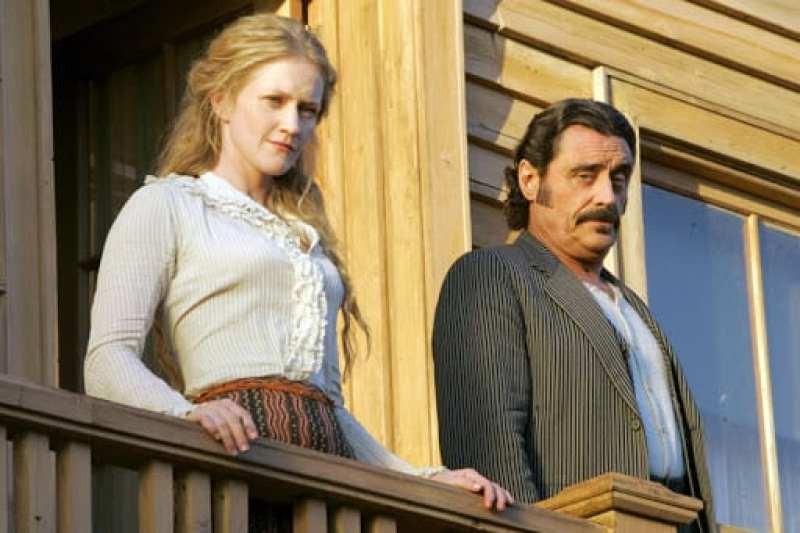 Trixie and Swearengen on the Gem balcony looking over Deadwood