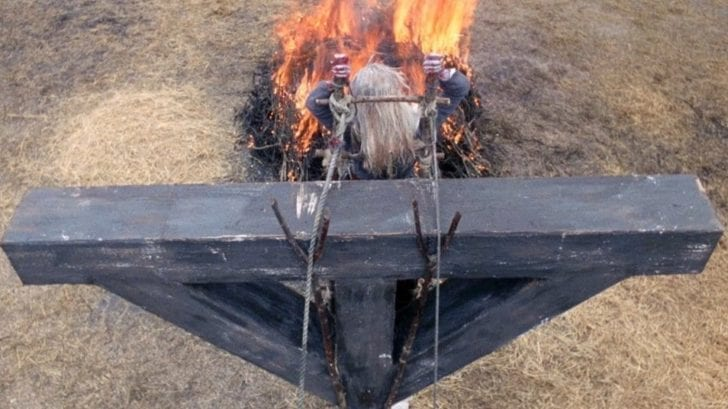 a woman is burnt on a cross in witchfinder general