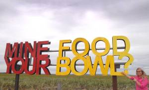 Huge sign on farmland says Mine your food bowl