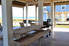 Large built-in picnic table to enjoy your favorite BBQ.