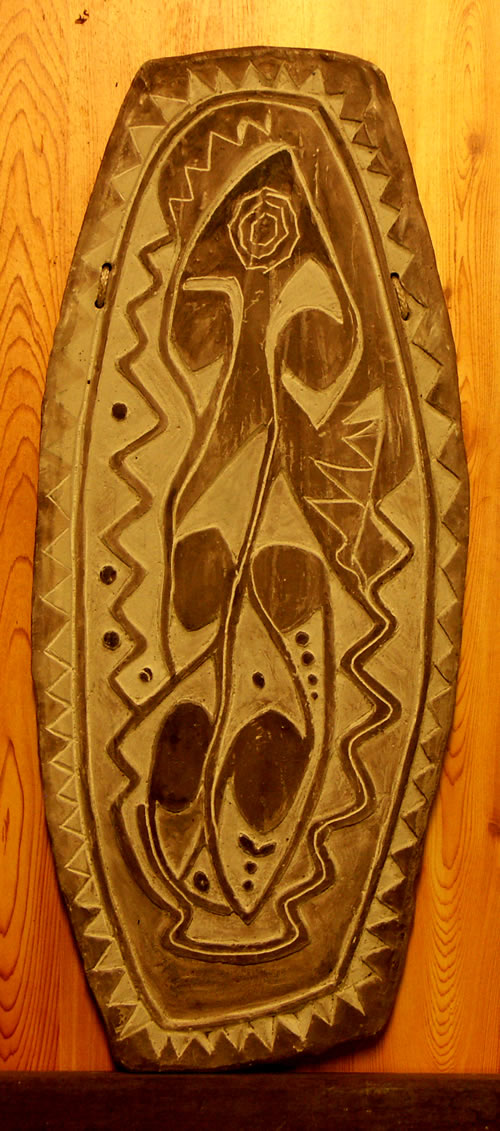 Copy of a timber shield from the Grass Country of the Upper Sepik, where tribal warfare still erupts from time to time.
