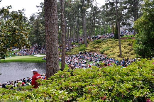 Fans gather to see the 7th, 8th, and 9th holes of the Par 3 Course at Augusta National.