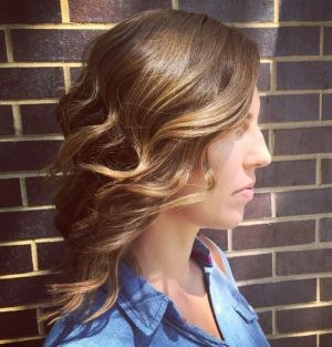 medium hairstyle with loose curls