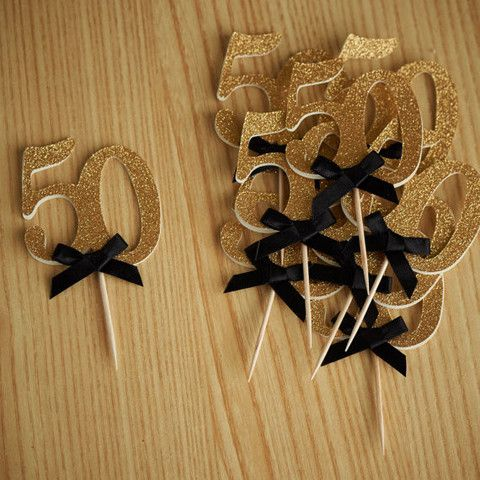 "These ""50"" toppers are so chic for a 50th birthday.  Definitely not passing these up!"
